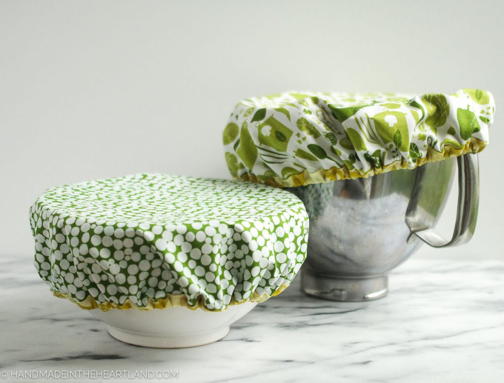 picture of 2 bowls with fabric mixing bowl covers covering the tops of each bowl