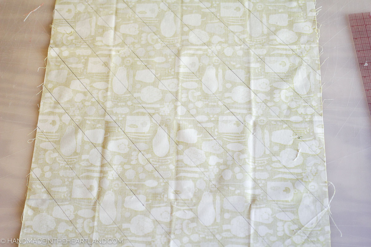 """a fat quart of fabric with 2"""" lines drawn onto the backside of the fabric on the diagonal to make bias tape"""