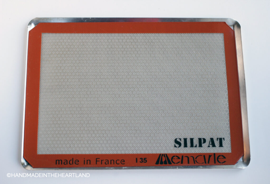 silpat nonstick baking liner sitting on a metal perforated baking sheet