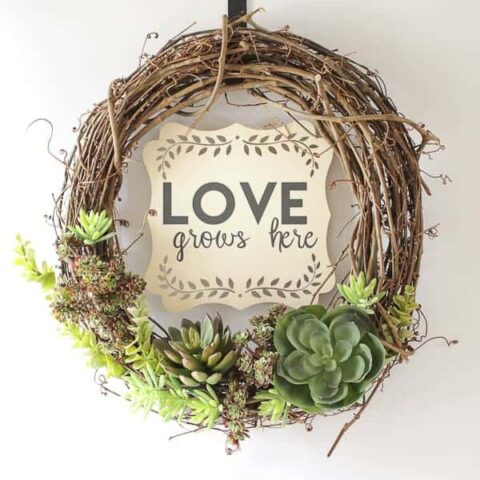 spring wreath made with faux succulent plants
