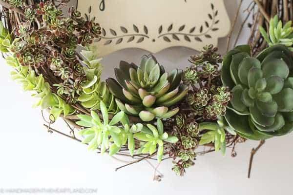faux succulents on a grapevine wreath