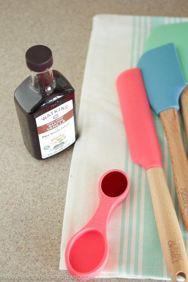 Measuring vanilla extract for strawberry shortcake cake