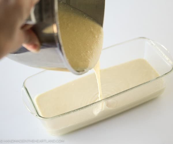 Pouring strawberry shortcake cake batter into pan