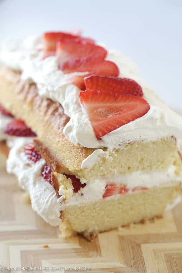 Layered strawberry shortcake cake with fresh strawberries