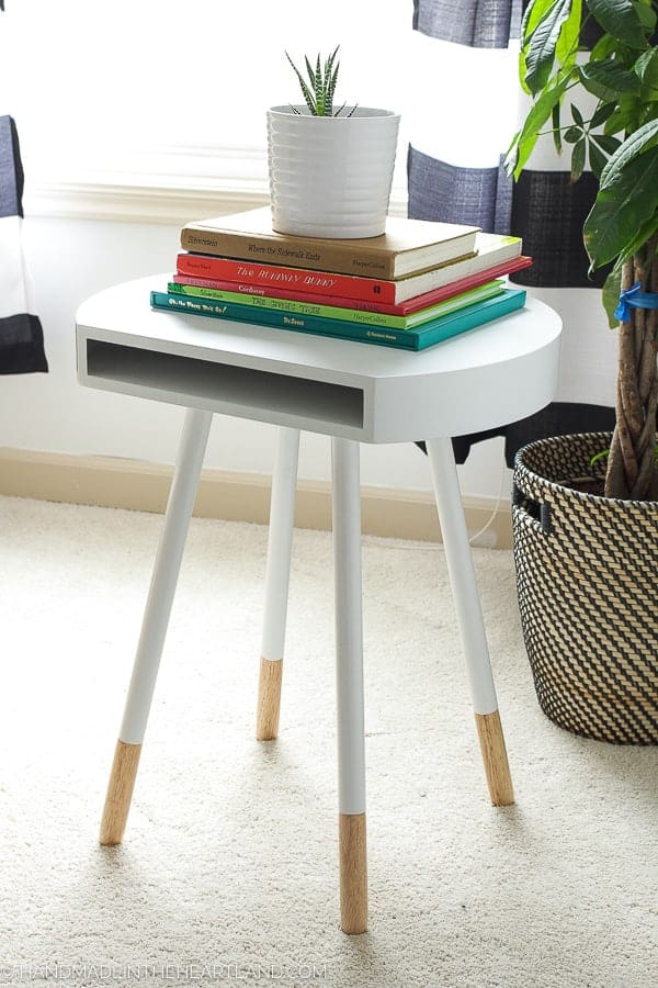 mid century modern end table with books style in a modern kids room