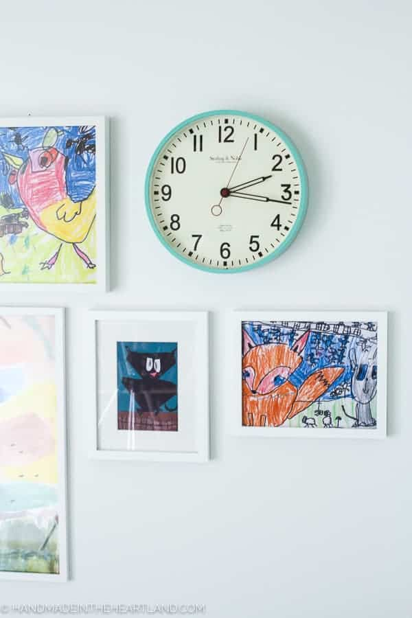 fun aqua clock and white frames purchased at walmart decorating modern kids room