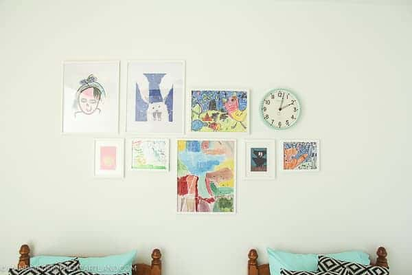 white walls with kids framed artwork in a modern kids room