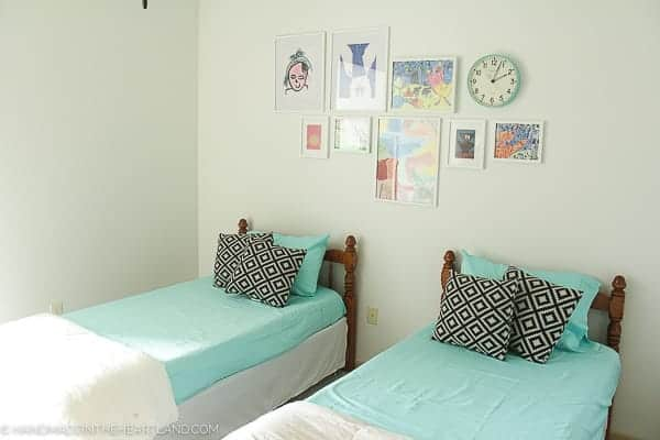 aqua bed sheets on two twin beds in a modern styled kids room