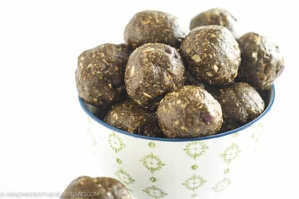 bowl full of peanut butter chocolate energy bite balls