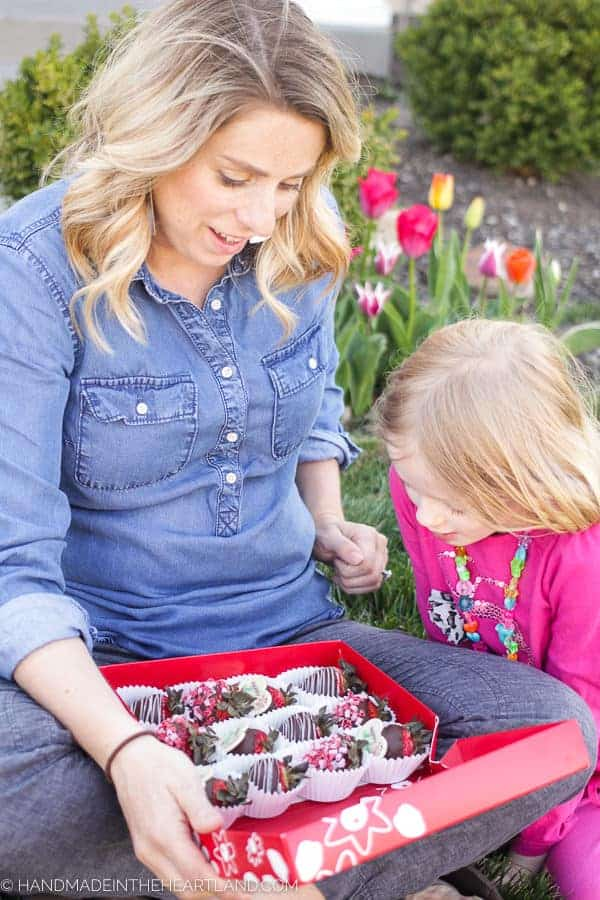 Mother and daughter sharing Edible Arrangements' chocolate covered strawberries
