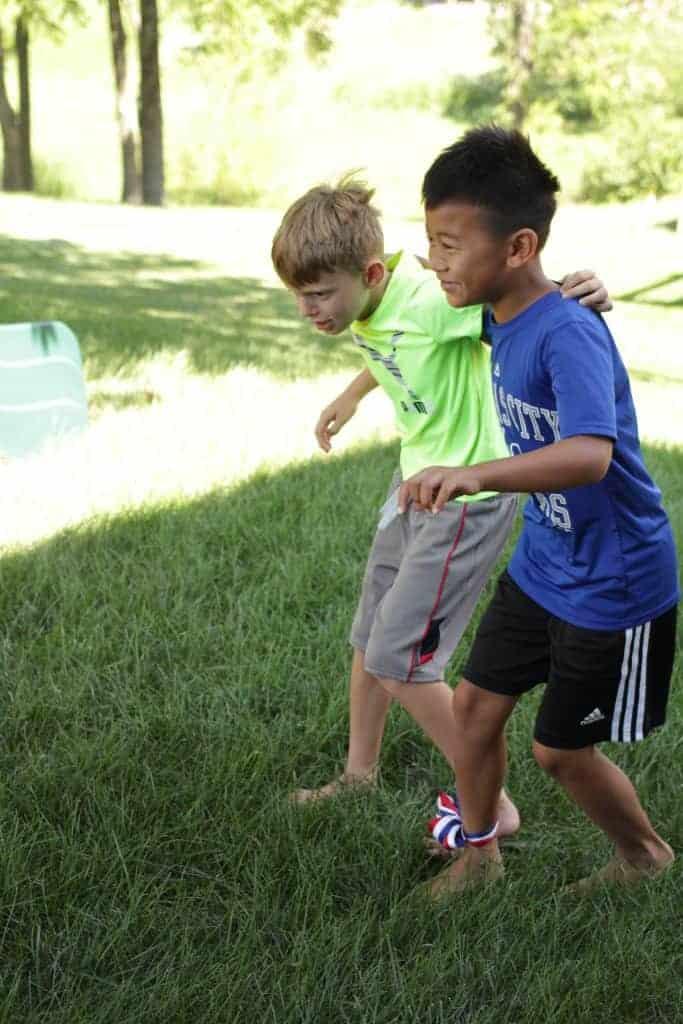 Image of 2 boys doing a three legged race