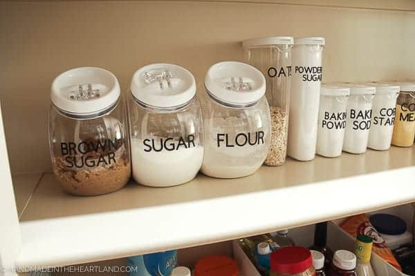 Image of pantry stapes like flour and sugar labeled in clear plastic containers