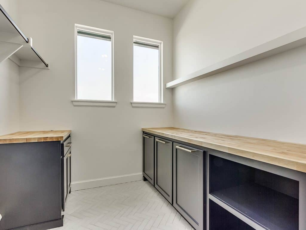 Laundry room lower cabinets & hampers painted Tricorn Black