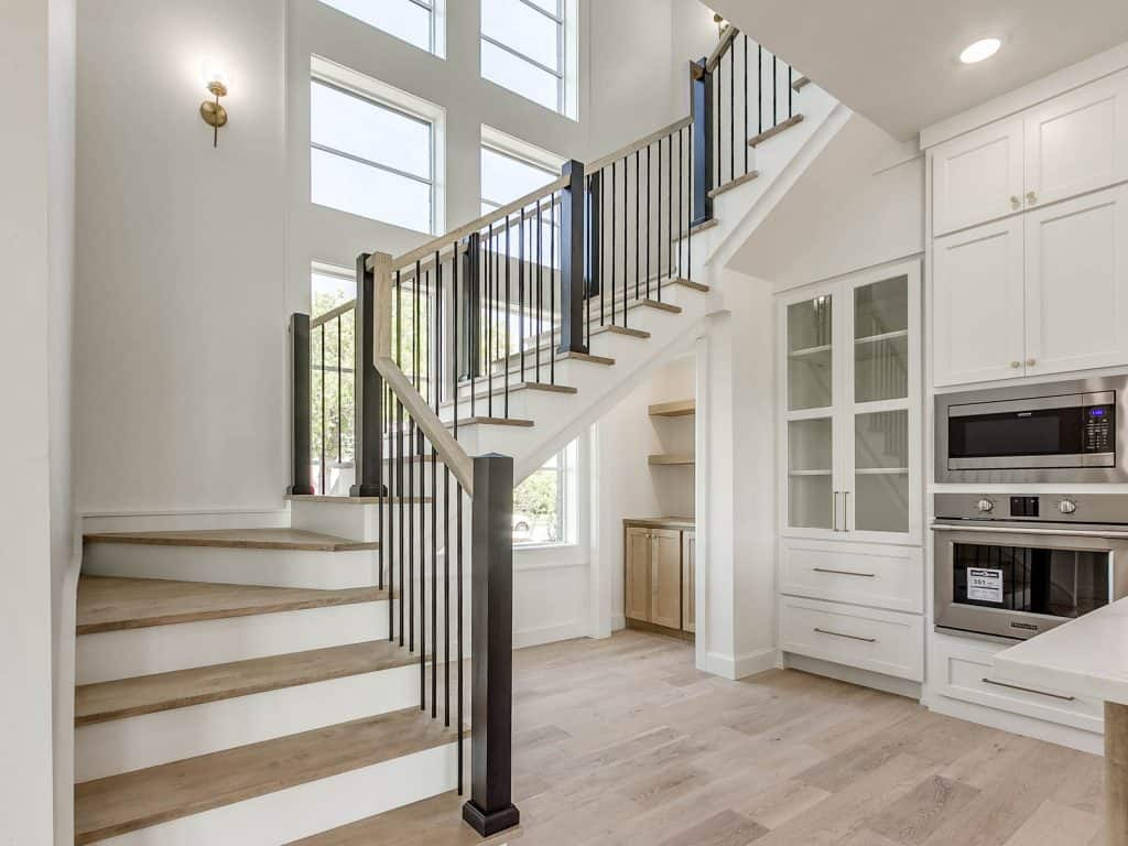 Stairwell and part of the kitchen with pure white painted walls