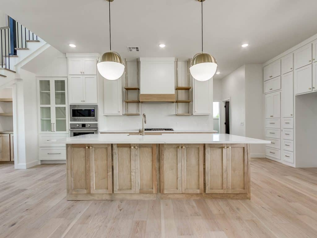 Modern farmhouse kitchen painted pure white with weathered oak wood stain