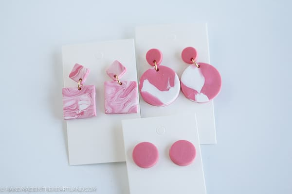 pink and white marbled polymer clay earrings on white earring cards