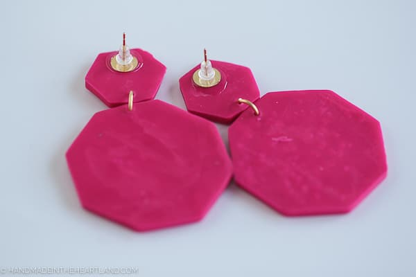 the back of polymer clay earrings with glued on earring posts