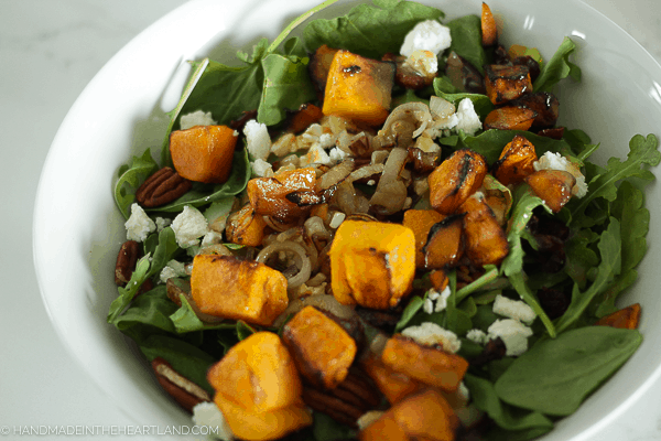 Roasted butternut squash salad with caramelized onions, pecans and goat cheese. Delicious healthy dinner