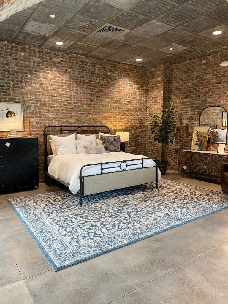 Bedroom furniture display at Magnolia Home