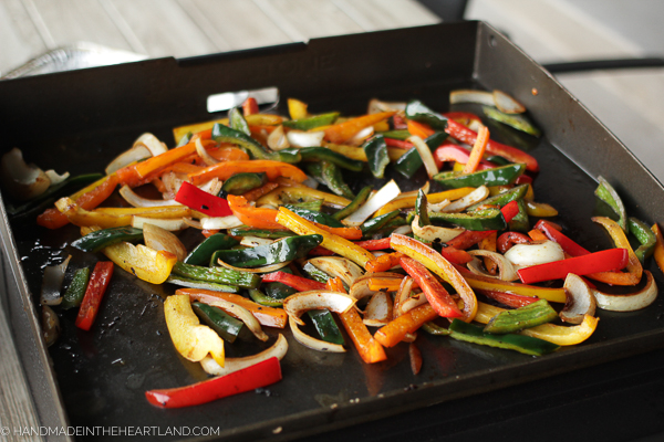 Cooked veggies about to be removed from Blackstone griddle