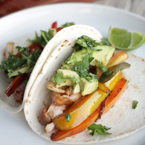 Blackstone Griddle Chicken Fajitas with avocado and cilantro