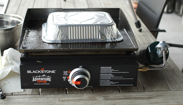 aluminum pan on griddle as cover for food