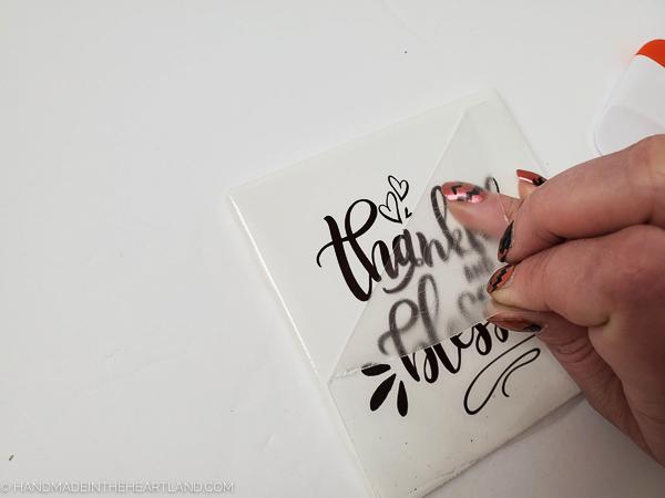peeling off transfer tape on vinyl lettering