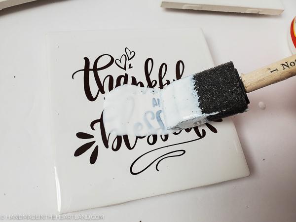 sealing vinyl lettering on ceramic tile with mod podge