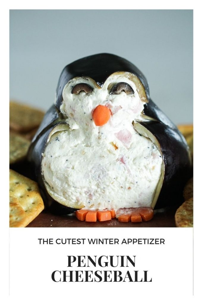 Image of a cheeseball decorated as a penguin