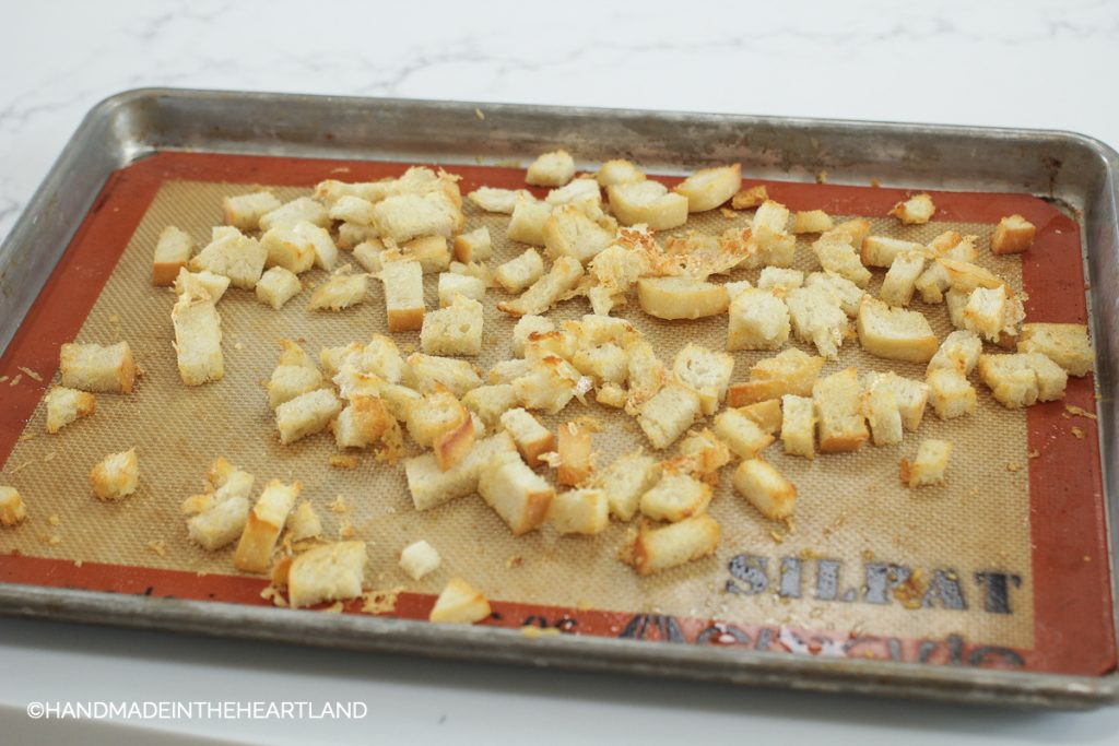 diced sourdough bread slices after coming out of the oven, now are croutons for soup
