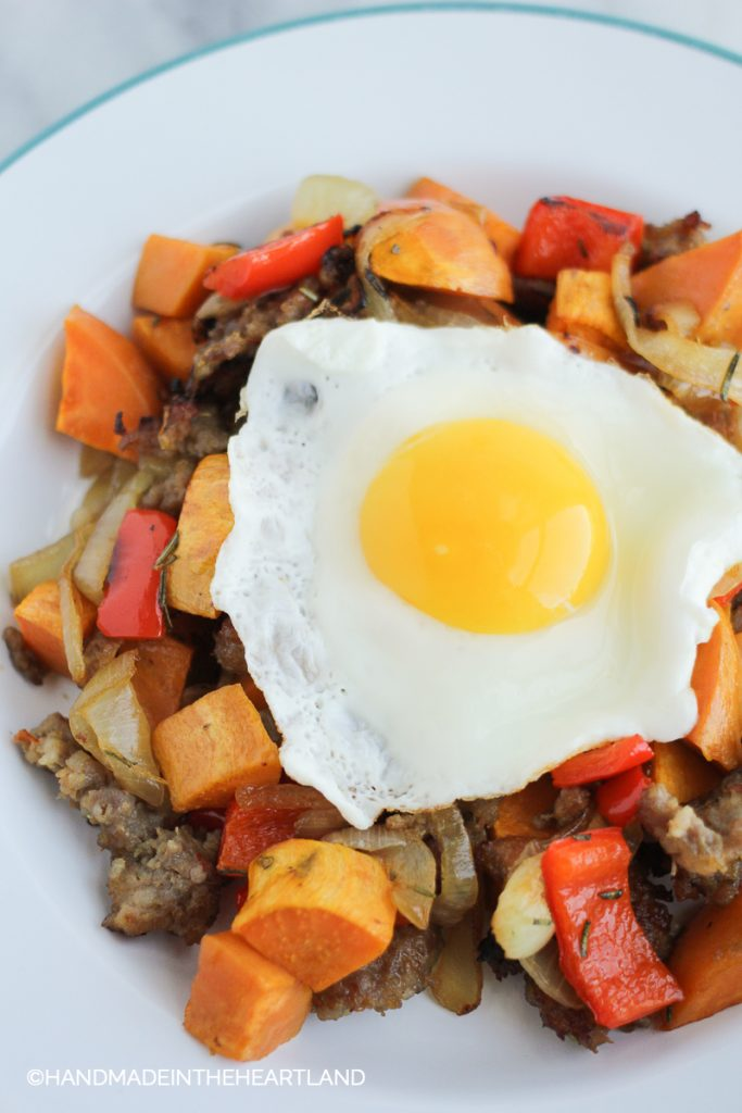 Image of roasted sausage, onions, bell pepper and sweet potato breakfast hash