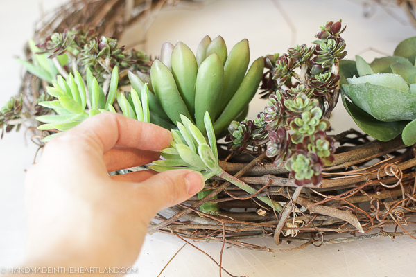 sticking stems into grapevine wreath