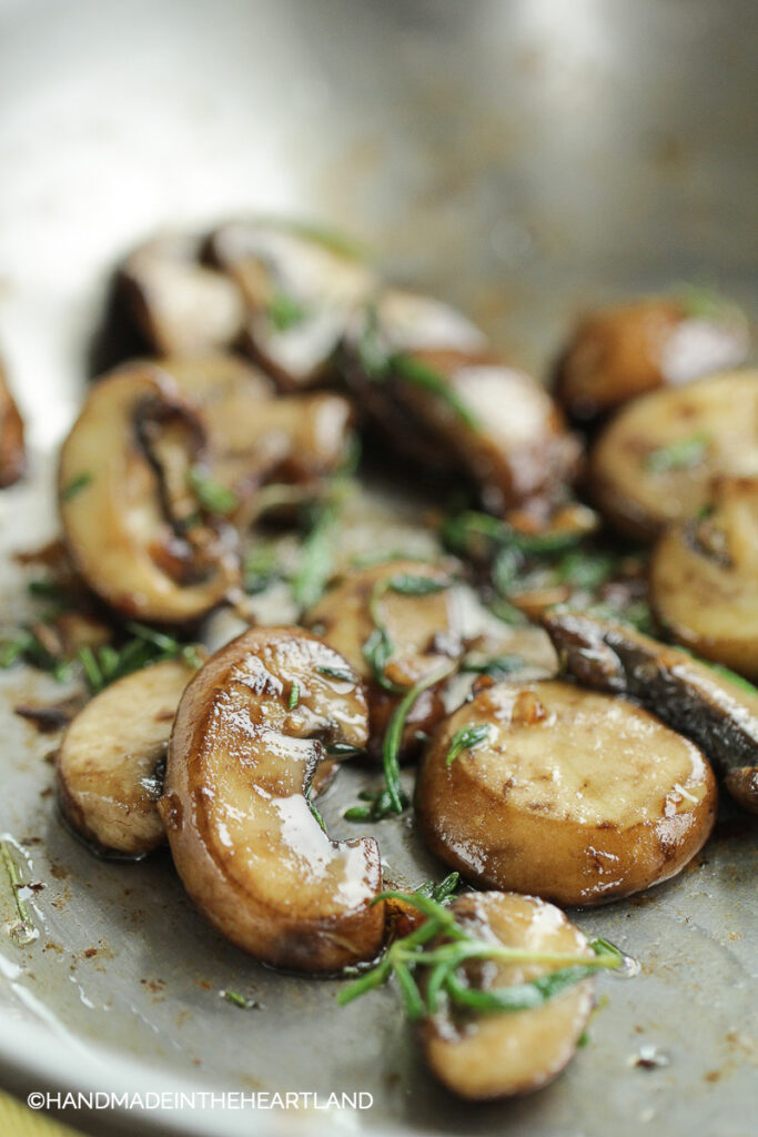Mushrooms, Garlic and rosemary sitting in a saute pan after cooking