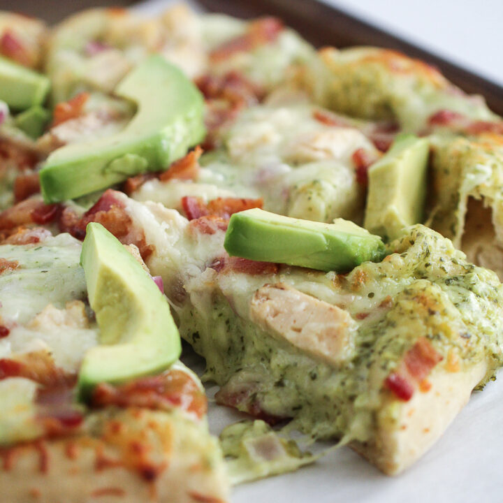 Pizza with chicken, bacon, ranch and avocado on top