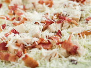 pre-cooked pizza with chicken, bacon and ranch toppings