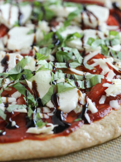 Pizza with fresh mozzarella and balsamic glaze before cooking