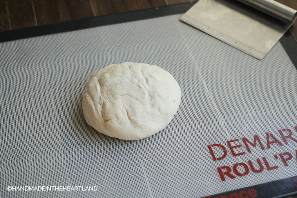 dough rolled into ball to rest for 10 minutes