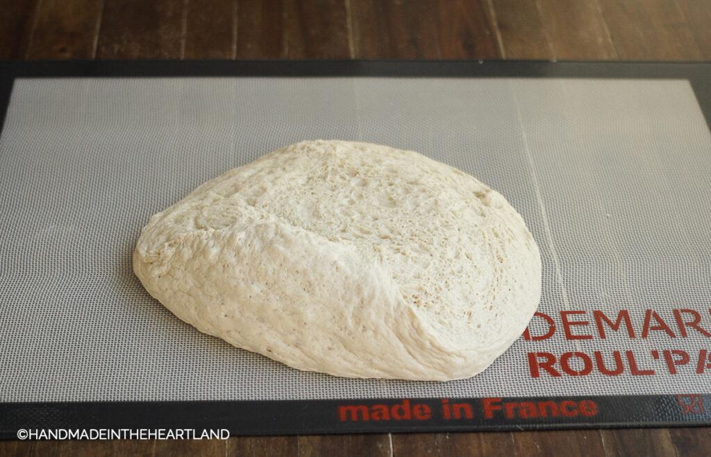 Pizza dough dumped out on non stick roul pat after 2 hour rise