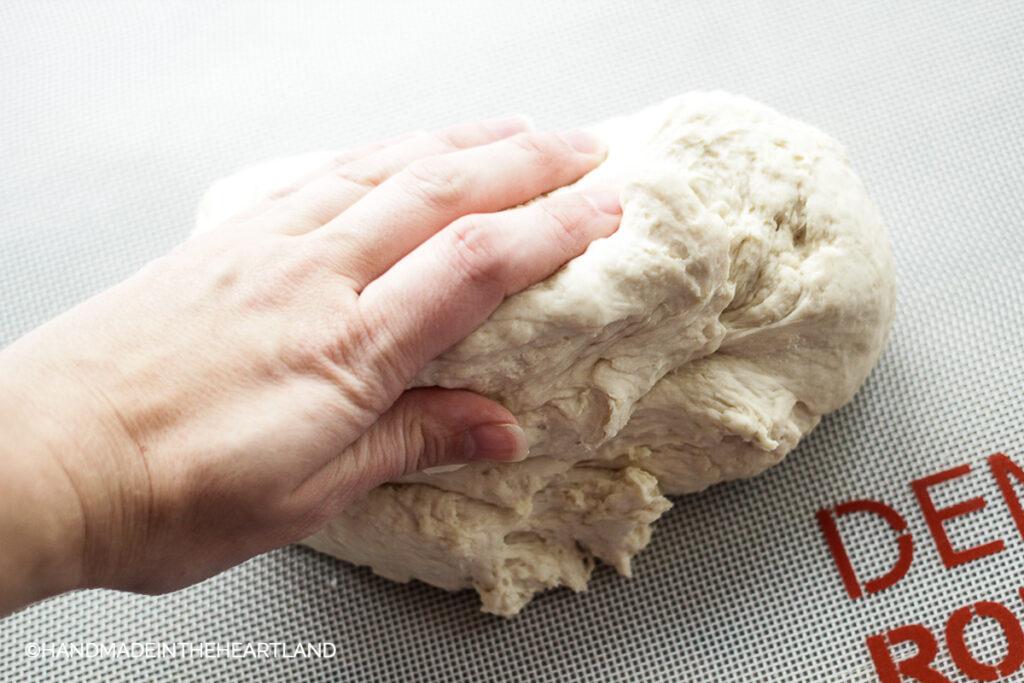dough on nonstick mat on counter