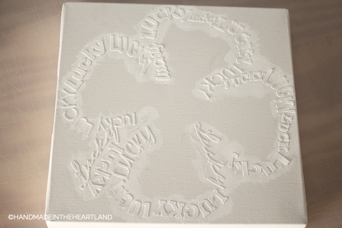 lucky chipboard letters painted white on white canvas