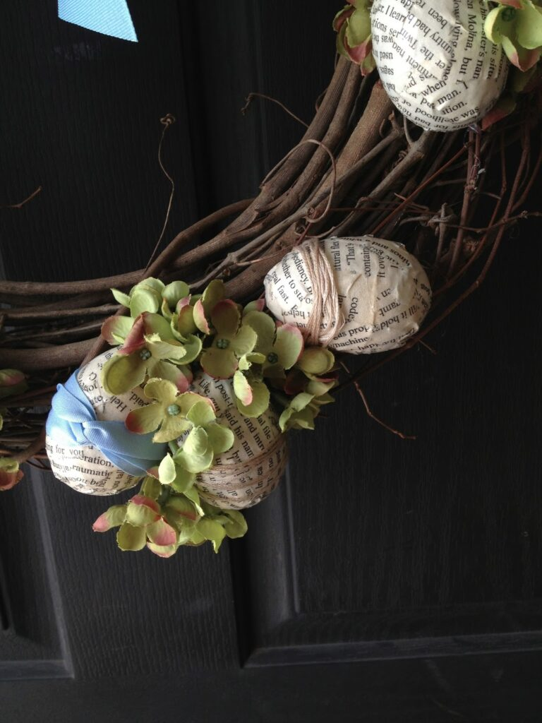 Decoupaged easter eggs with book pages and ribbon
