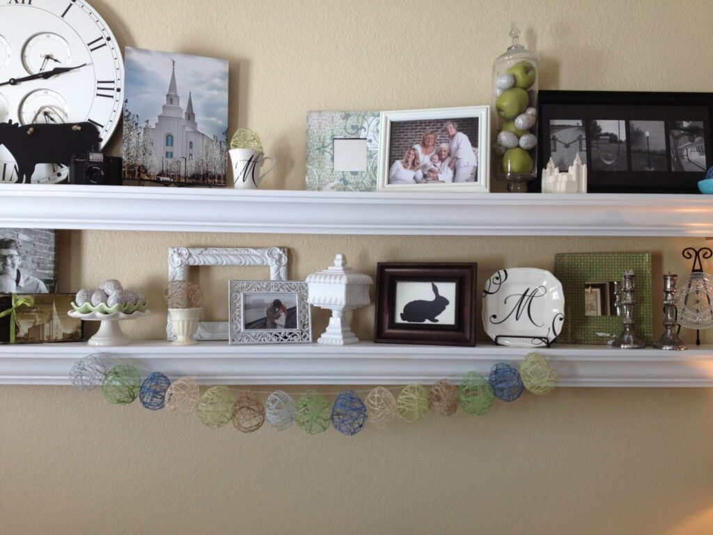 Easter decorated wall shelves with decoupaged book page easter eggs